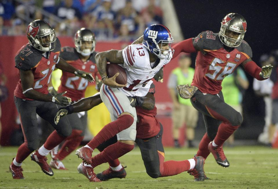 New York Giants wide receiver Odell Beckham (13) runs with a reception against Tampa Bay Buccaneers defenders, including Kwon Alexander (58) and cornerback Alterraun Verner (21) during the fourth quarter of an NFL football game Sunday, Nov. 8, 2015, in Tampa, Fla. (AP Photo/Phelan M. Ebenhack)