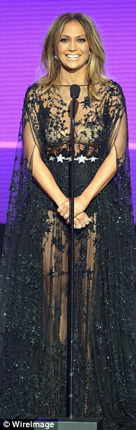2EB6566100000578-3329962-Star_power_The_singer_next_wore_a_flowing_sheer_black_gown_in_a_-m-54_1448256461334
