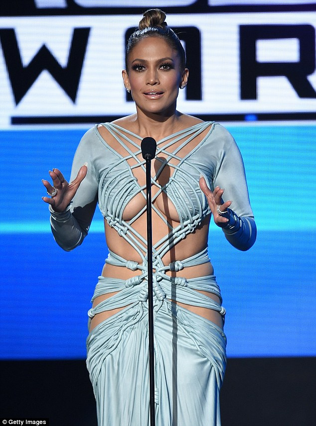 2EB7B77400000578-3329962-Final_look_J_Lo_went_for_another_body_hugging_dress_as_she_wrapp-a-37_1448255005337