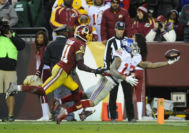 Nov 29, 2015; Landover, MD, USA; New York Giants wide receiver Odell Beckham (13) scores a touchdown in front of Washington Redskins cornerback Will Blackmon (41) during the second half at FedEx Field. The Redskins won 20-14. Mandatory Credit: Brad Mills-USA TODAY Sports