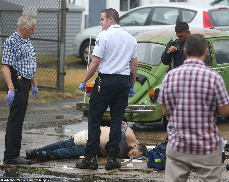 3895591b00000578-3796411-rahami_is_pictured_laying_on_the_ground_with_his_hands_restraine-m-122_1474313759836